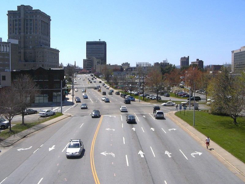 Even with five turn lanes, this signalized intersection in downtown Asheville still functioned poorly and held back economic revitalization.