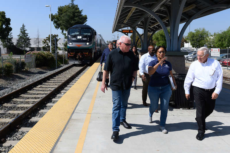 Metrolink CEO Stephanie Wiggins escorts Federal Railroad Administration Administrator Ronald Batory (right) and Metrolink Board Chair Brian Humphrey on a tour of the Metrolink Pomona-North Station.