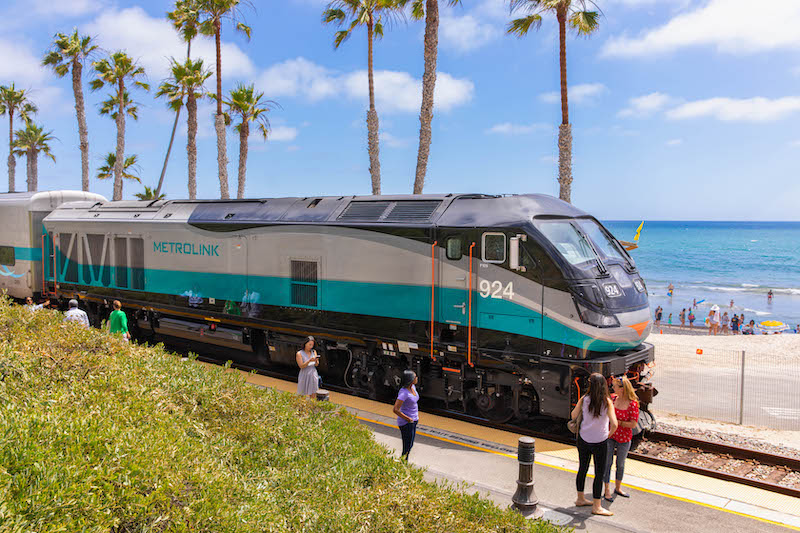Metrolink Tier-4 locomotive drops off passengers at the San Clemente Pier Station.