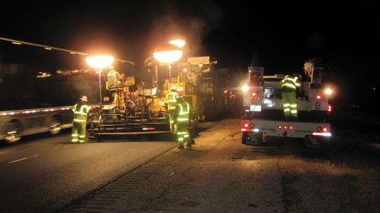 Personal illumination keeps workers visible to motorists at night.