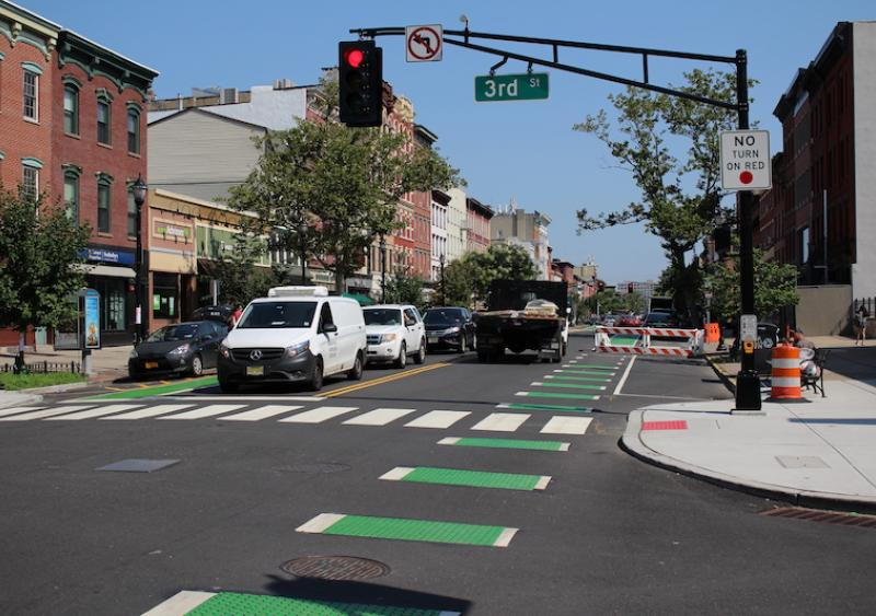 A Washington Street intersection after construction, featuring new signals, curb extensions, and bike lanes.